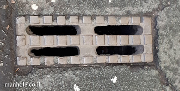 London - narrow rectangular drainage cover