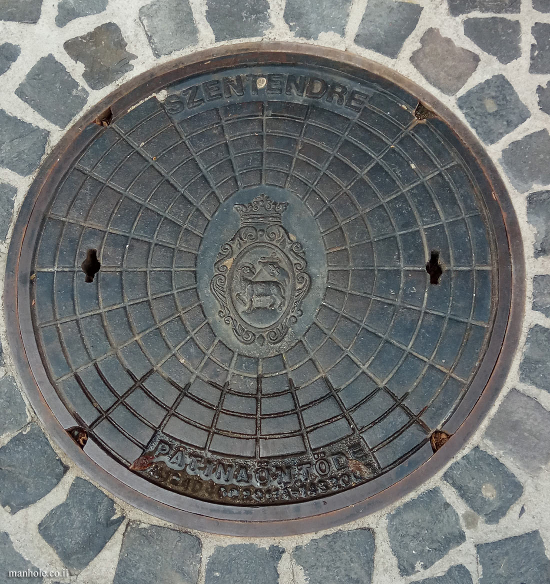 Szentendre - A lid with a network of circles and the city symbol in the center