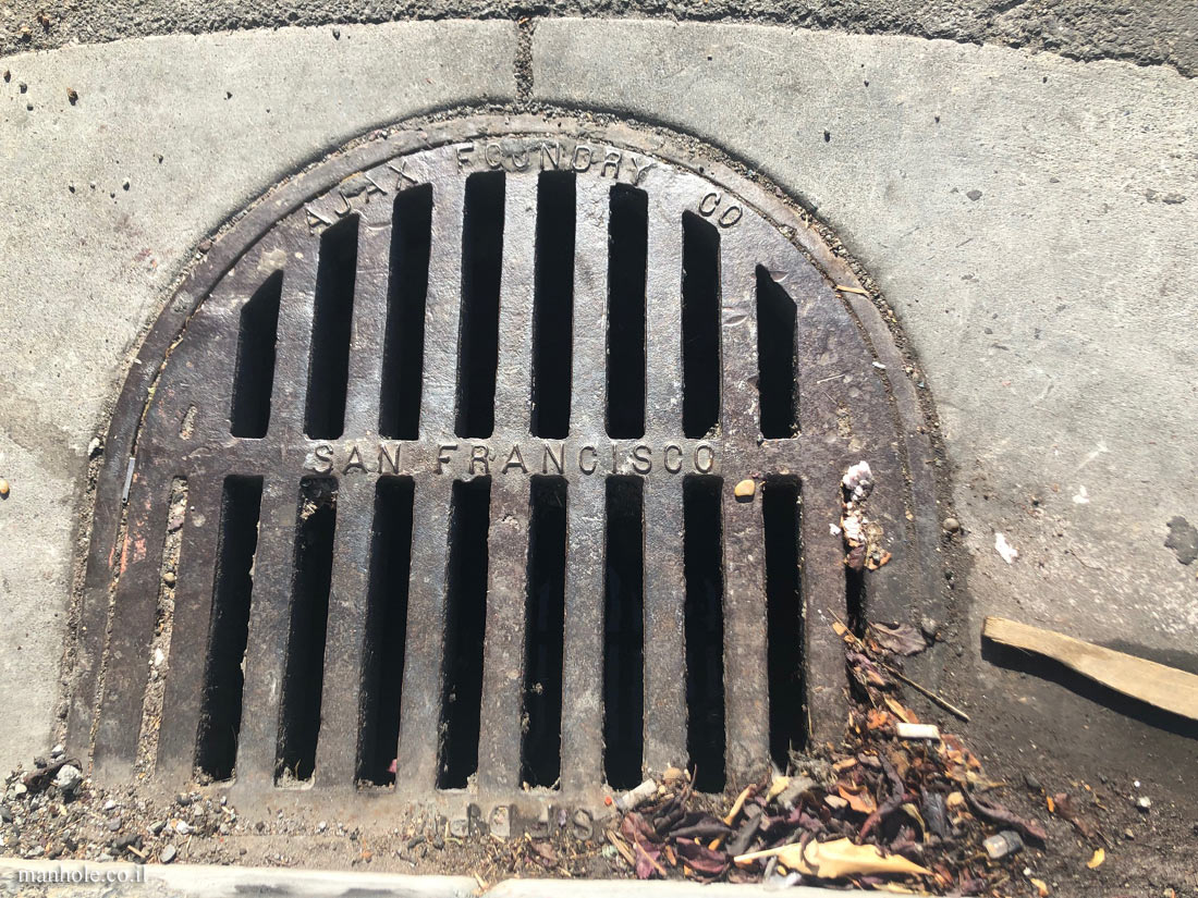 San Francisco - sidewalk drainage - half oval shaped cap