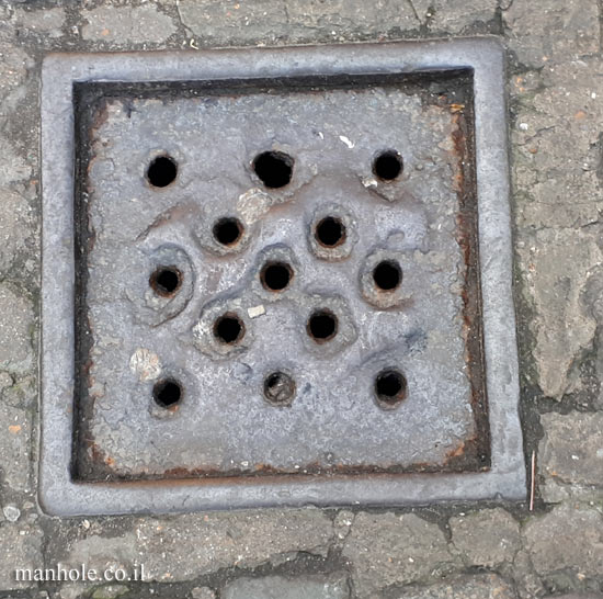 London - Drainage - Camden Market - small square with holes